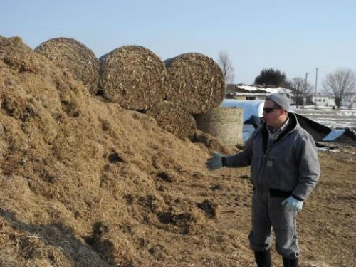 Justin Rowe shows fooder at his farm on March 8, 2013 in Dallas Center, Iowa