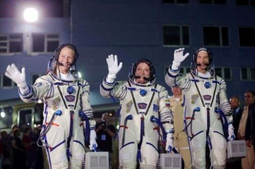 Karen Nyberg (L), Fyodor Yurchikhin (C) and Luca Parmitano during a sending-off ceremony in the Baikonur cosmodrome