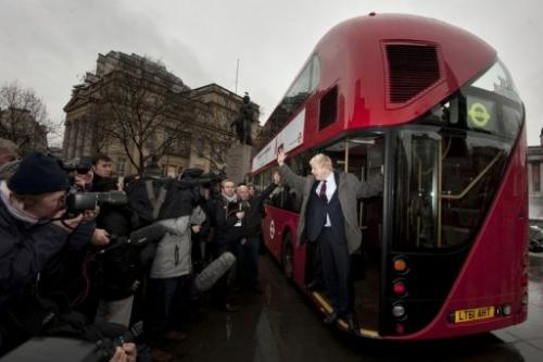 London Mayor Boris Johnson introduces a new prototype London bus using hybrid technology in London on December 16, 2011