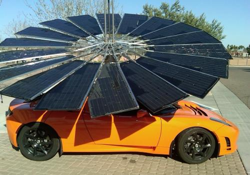 Tesla with solar power umbrella