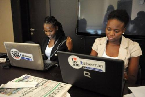 Marketing officers with job-finder site Jobberman work on June 17, 2013, in the upmarket Lagos suburb of Lekki