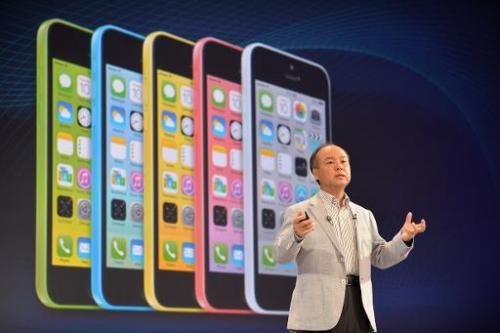 Masayoshi Son, chairman and CEO of Japan's SoftBank Corp, introduces Apple's iPhone 5c, during a press briefing in Tokyo, on Sep