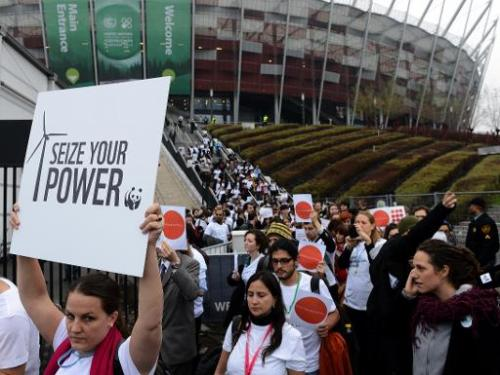 "Members of NGOs walk out of a UN climate change conference in Warsaw on November 21, 2013, saying the talks were ""on track"