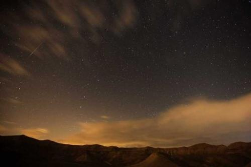 Meteor streaks are seen above the desert near the Israeli Kibbutz of Ein Gedi, early on December 14, 2012