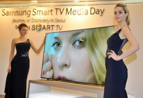 Models present Samsung's 75-inch F8000 Smart LED TV during a media conference in Seoul on February 19, 2013