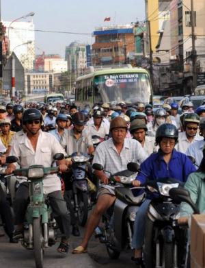 Motorbikes steam through Ho Chi Minh City in Vietnam on February 25, 2009