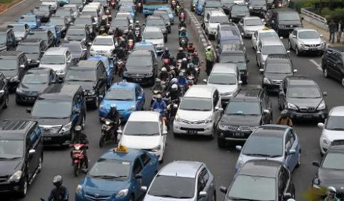 Motorists are trapped in the rush-hour gridlock in Jakarta, on October 21, 2013