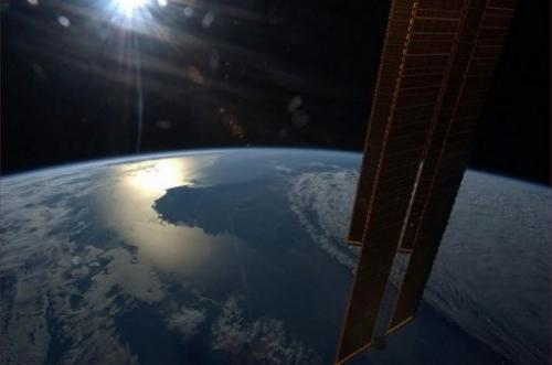 NASA handout image captured on board the ISS on April 2, 2013, shows the sun getting ready to set over Australia