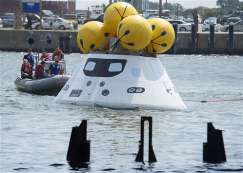 NASA, Navy practice space-capsule recovery