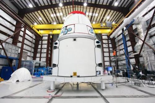 NASA photo on February 19, 2013 shows the SpaceX, Dragon spacecraft  in a hangar at Cape Canaveral