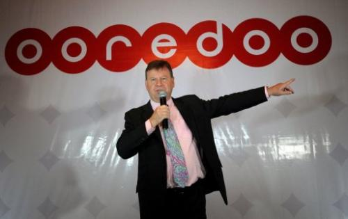 Ooredoo executive Ross Cormack speaks to the media during a press conference in Yangon, on August 16, 2013