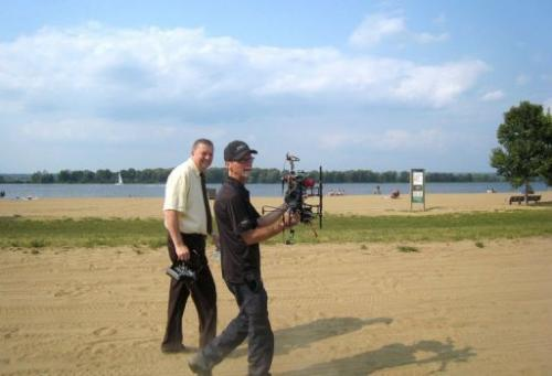Ottawa city councilor Bob Monette (L) and hexacopter owner Steve Wambolt walk at Petrie Island beach