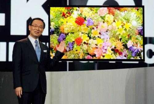 Panasonic Corporation President and CEO Kazuhiro Tsuga unveils the 4K OLED televison on January 8, 2013 in Las Vegas