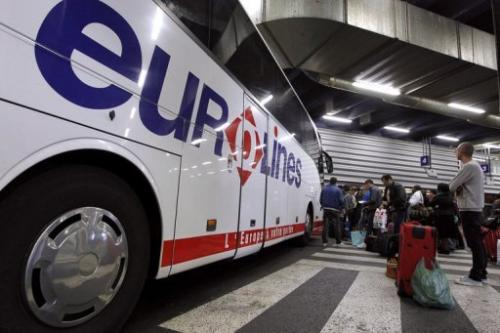 Passengers queue in an international bus terminal in Bagnolet, outside Paris, on June 4, 2012