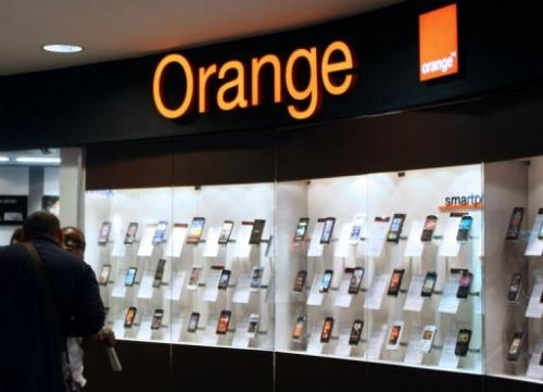 People are seen in an Orange store on July 19, 2012 in Paris