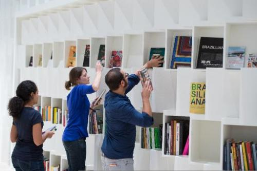 People prepare the Brazil booth on October 7, 2013 ahead of the Frankfurt book fair