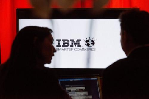 People speaks in front of IBM screen on November 14, 2012 in Paris