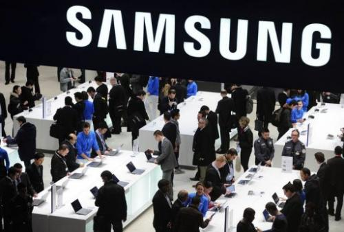 People visit a Samsung stand in Barcelona on February 26, 2013