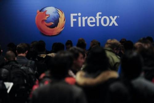 People wait to attend the press conference of Mozilla's Chief Executive Officer (CEO) in Barcelona on February 24, 2013