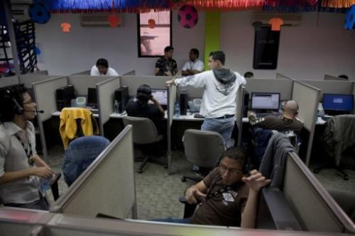 People work at SITEL, an outsourcing call center provider, in Managua, Nicaragua on July 03, 2012