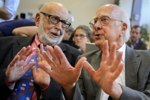 Peter Higgs (R) speaks with Francois Englert on July 4, 2012 at CERN offices in Meyrin near Geneva