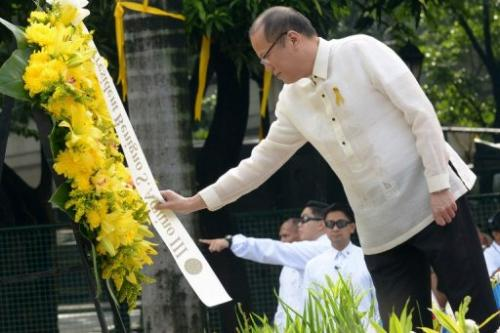 Philippine President Benigno Aquino lays a wreath in Manila on June 12, 2013