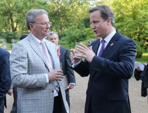 Prime Minister David Cameron (R) speaks with Eric Schmidt of Google during a reception on July 26, 2012, in London