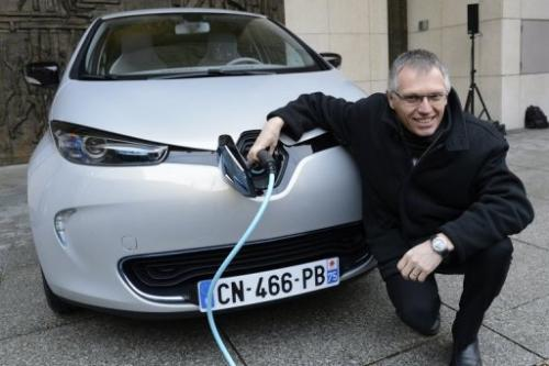 Renault chief operating officer Carlos Tavares with a Zoe electric car in Paris on December 17, 2012