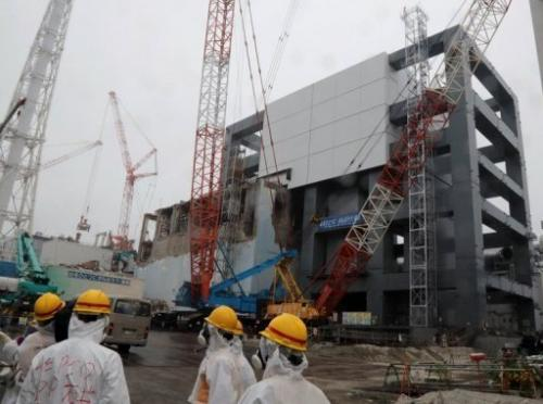 Reporters and Tokyo Electric Power Co workers during a tour of the Fukushima nuclear plant on June 12, 2013