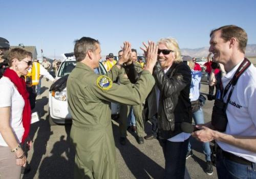 Richard Branson and pilot Mark Stucky celebrate the successful flight of SpaceShipTwo on April 29, 2013