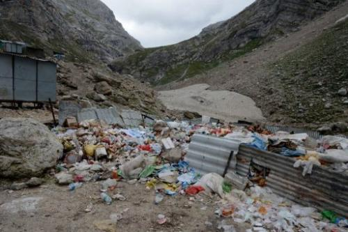 Rubbish lies in a partially fenced off area along the track to the Amarnath cave shrine on August 18, 2013