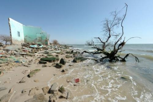 Ruins of a house  are seen on May 7, 2013 on the beach of the village of Doun Baba Dieye, northern Senegal