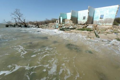 Ruins of houses are seen on May 7, 2013 on the beach of the village of Doun Baba Dieye, northern Senegal