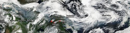 Satellite quilt of wildfires, smoke throughout Canada