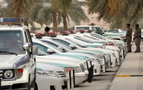 Saudi police cars are parked outside the Al-rajhi mosque in central Riyadh, on March 11, 2011