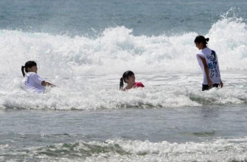 Schoolgirls play on Toyoma Beach, some 50 kilometres south of the Fukushima nuclear power plant, on August 24, 2013