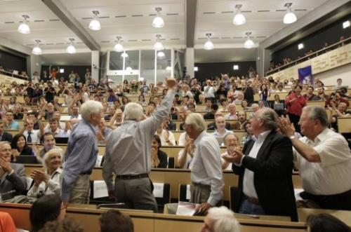 Scientists applaud during a seminar at CERN facility in Meyrin, near Geneva, on July 4, 2012