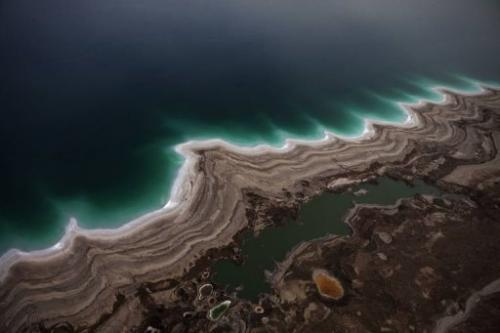 Sinkholes created by the drying of the Dead Sea are pictured near Kibbutz Ein Gedi on November 10, 2011