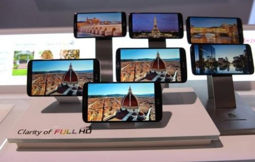 Smartphones on display during a global launch event in New York on, August 7, 2013