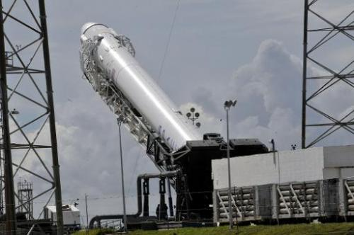 SpaceX's Falcon 9 rocket, with the Dragon space craft, seen preparing for a launch on October 7, 2012 from Cape Canaveral, Flori