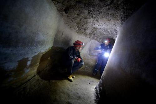 -'Speleo-archaeologists' make their way through a perfectly preserved tunnel in a section of the Acqua Claudia aqueduct, on the