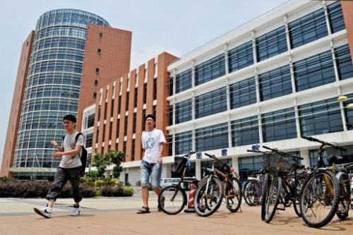 Students walk out of the library of Shanghai Jiaotong University, on August 3, 2010