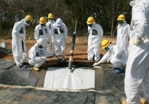 TEPCO officials inspect radioactive reservoirs at the Fukushima Dai-Ichi facility in Okuma, on April 13, 2013.