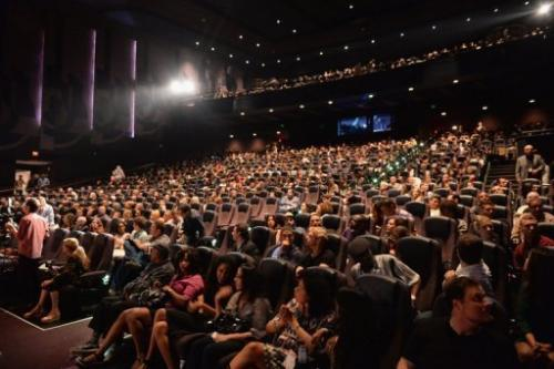 The audience applauds after a show at Regal Cinemas, Los Angeles, California, June 17, 2013