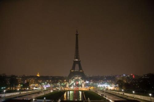 The Eiffel Tower is seen as its illuminations are switched off as part of Earth Hour on March 23, 2013 in Paris