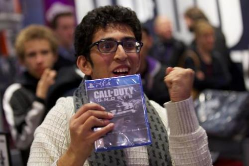 The first customer picks up Call of Duty: Ghosts in a shopping centre in east London at its midnight launch on November 4, 2013