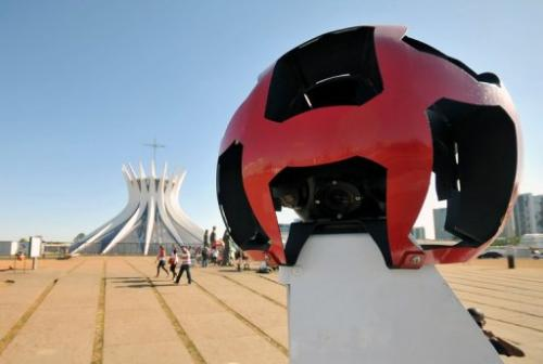 The Google street view mapping and camera vehicle drives in front of Brasilia's cathedral on September 6, 2011