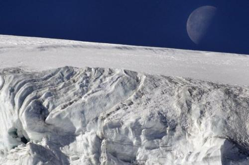 "The moon seen above the ""Feegletscher"" in Switzerland on November 1, 2007"
