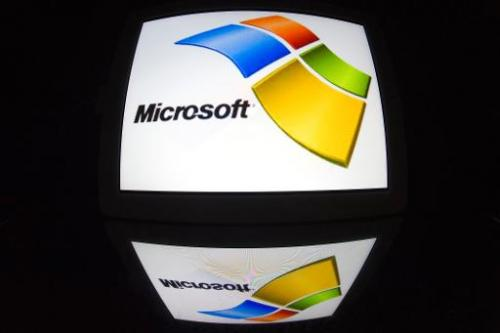 "The ""Microsoft"" logo is seen on a tablet screen on December 4, 2012 in Paris"