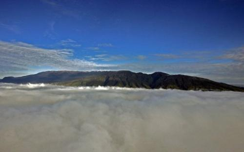 The summit of Mount Hagen towers above the clouds covering the Western Highlands of Papua New Guinea, on July 4, 2007